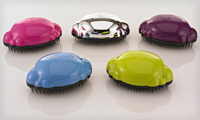 Knot Genie Detangling Brush: $9 for a Knot Genie Detangling Brush ($19.99 List Price). Five Colors Available.