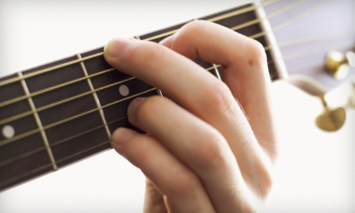 Strum & Sip - Multiple Locations: 4 or 12 Group Guitar Lessons at Strum & Sip (Up to 73% Off)
