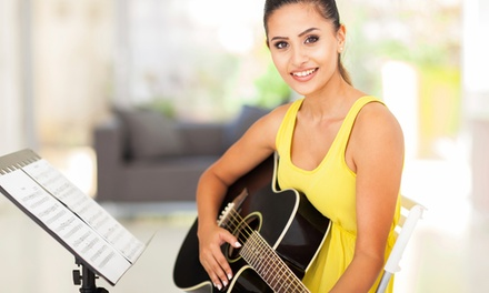 $99 for Rock 101 - Four Private Music Lessons and Four Group Lessons at School of Rock ($200 Value)