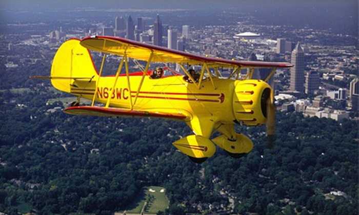 Biplane Rides Over Atlanta - 57th Fighter Group Restaurant: $87 for an Open-Air Biplane Ride Over Downtown Atlanta or Stone Mountain from Biplane Rides Over Atlanta ($175 Value)