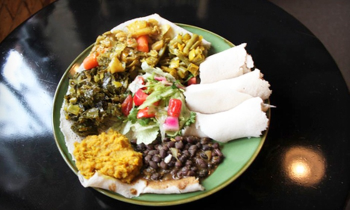 GoJo Ethiopian Cuisine - Eastown: Ethiopian Dinner for Two or Four with Vegan or Spiced Chicken Platters at GoJo Ethiopian Cuisine (Up to 52% Off)