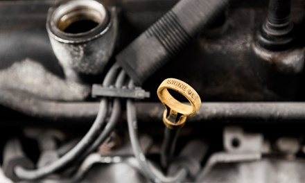 Oil Changes with Inspections and Tire Rotations or Wheel Alignment at Lucas Tire & Auto Care (Up to 82% Off)