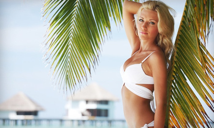 Naked Tan - Pacific Beach: One Month of Unlimited UV Tanning or Three VersaSpa Spray Tans at Naked Tan (Up to 78% Off)
