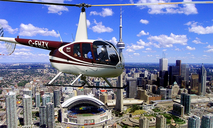 Toronto Heli Tours - Billy Bishop Toronto City AIrport: 15-Kilometre Aerial Tour with a Digital Photo for One or Three from Toronto Heli Tours (Up to 53% Off)