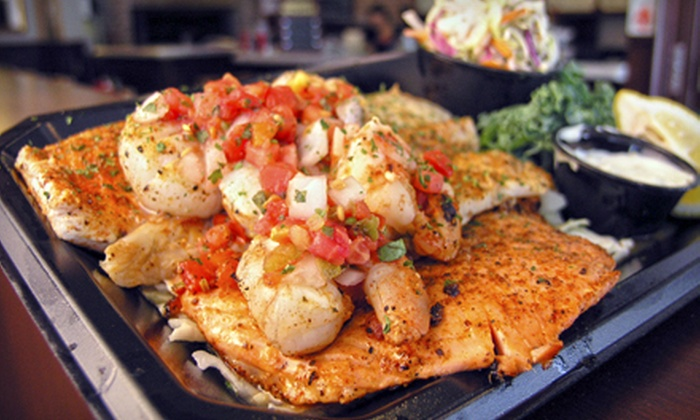 The Tin Fish - Downtown West Palm Beach: Seafood Meal for Two or Four or $10 for $25 Worth of Beer, Wine, and Cocktails at The Tin Fish