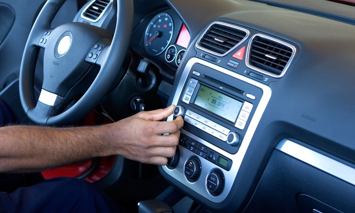 Tunes-N-Tint/Alarms Etc. - Multiple Locations: $60 for a Car-Stereo Auxiliary Input with Installation at Tunes-N-Tint/Alarms Etc. ($129.99 Value)