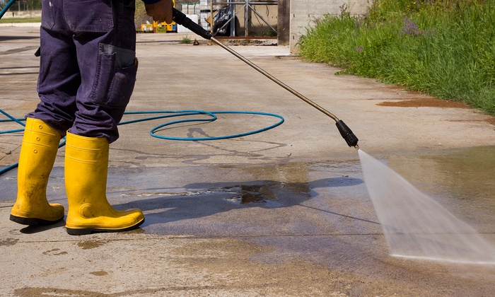 TNT Pressure Washers - Southbelt/ Ellington: Power Washing of a One-Story Home or Four-Car Driveway from TNT Pressure Washers (50% Off)