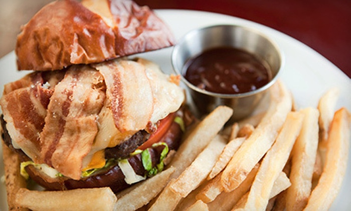 Mandangos Sports Bar & Grill - Lead Hill: Two Appetizers and Four Drinks for Four or $15 for $30 Worth of American Food at Mandangos Sports Bar & Grill