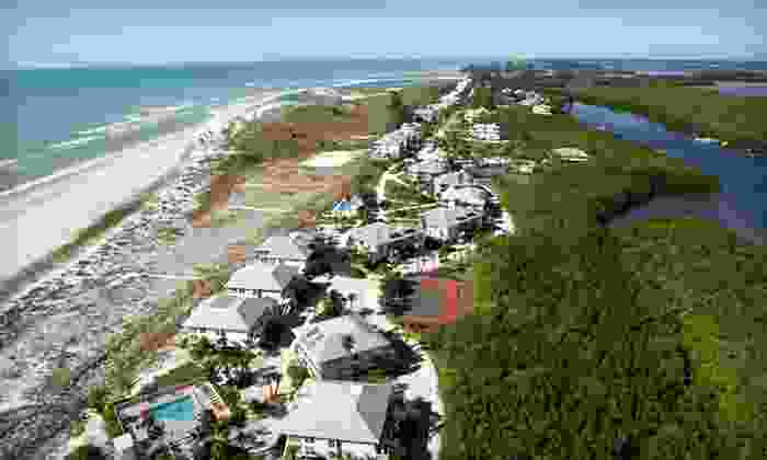 Palm Island Resort - Grove City-Rotonda: Two-Night Stay with Golf-Cart Rental and Beach Towel at Palm Island Resort in Cape Haze, FL