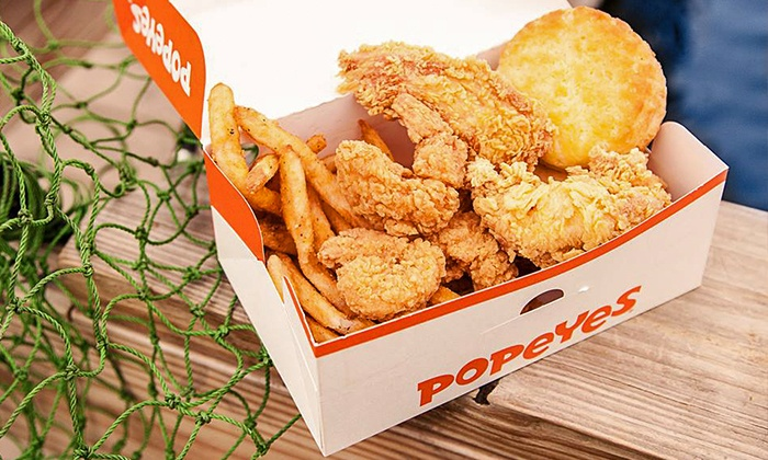 Popeyes® Louisiana Kitchen - Multiple Locations: 12-Piece Family Meal with Biscuits and Sides or Two Groupons, Each Good for $10 at Popeyes Louisiana Kitchen