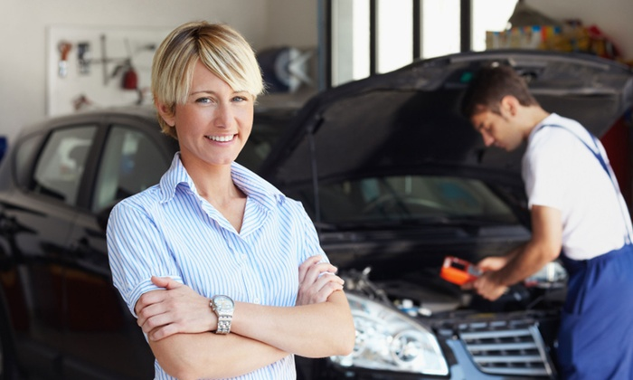 Auto Care Special - Boston: $33 for Three Oil Changes, Two Tire Rotations, Engine-Light Check, and Inspections from Auto Care Special ($199 Value)