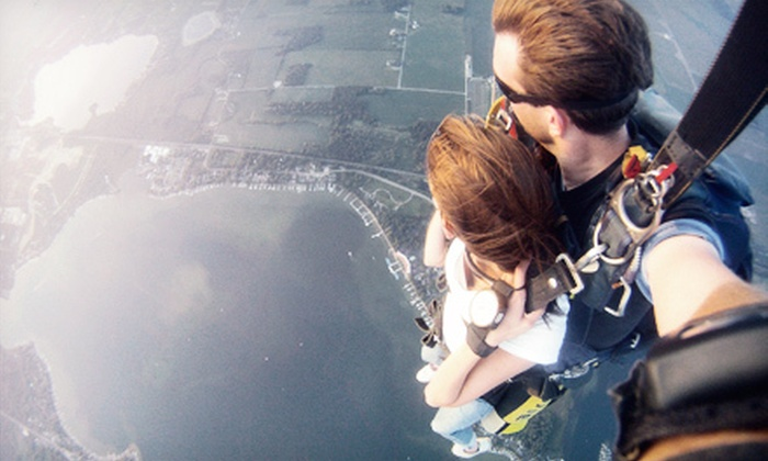 Skydive Lake Wawasee - Turkey Creek: Tandem Skydive for One, Two, or Four with Photo Package from Skydive Lake Wawasee (Up to 51% Off)