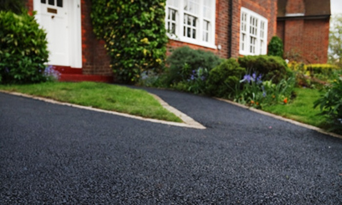J&D Landscaping & Lawn Care Inc. - Burrillville: Sealcoating for a Two-, Four-, or Eight-Car Driveway from J&D Landscaping & Lawn Care Inc. (Up to 51% Off)