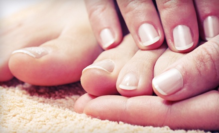 Regular or Shellac Mani-Pedi with Paraffin Wax and Hand or Foot Massage at Top Models Salon & Boutique (Up to 55% Off)