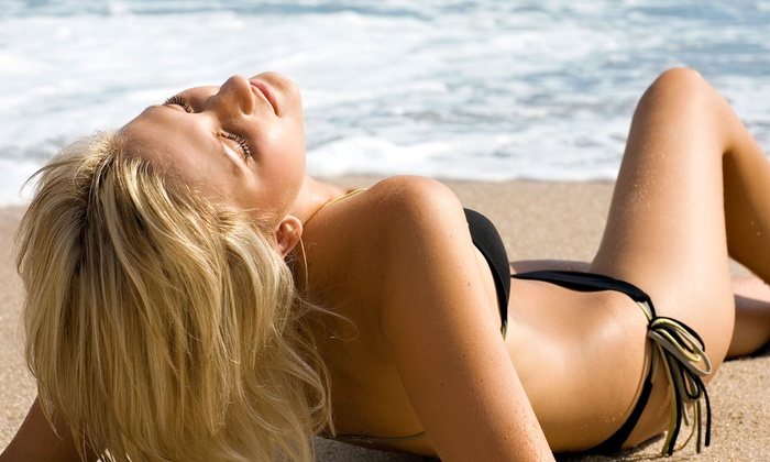 Tans To Go - Transit Village: One, Three, or Five Spray Tans at Tans To Go (Up to 55% Off)