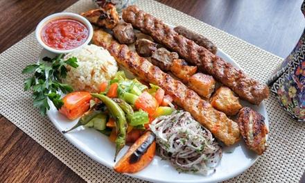 Grigliata di carne, falafel e birra