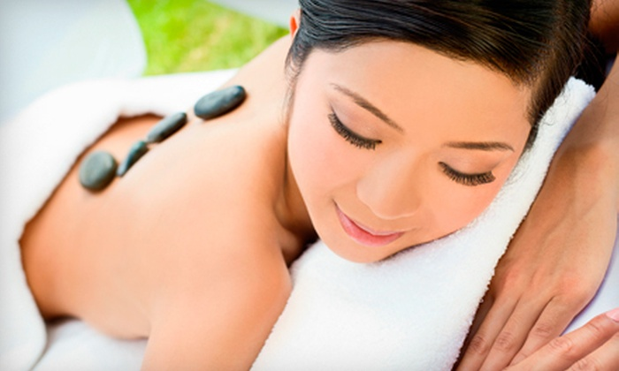 Rejuvinate Massage Therapy - Northland: 60-Minute Hot-Stone Massage for One or Two at Rejuvinate Massage Therapy (Up to 56% Off)