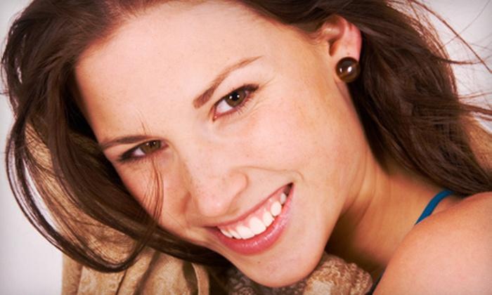 Pro White Teeth Whitening - Multiple Locations: $29 for One Complete Teeth-Whitening Session at Pro White Teeth Whitening ($129 Value)
