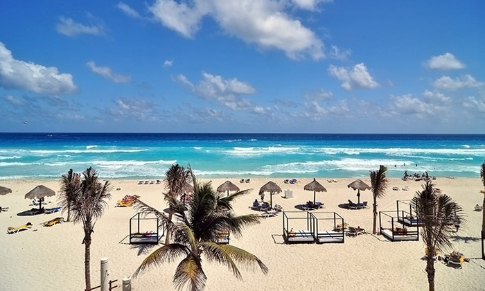 All-Inclusive Grand Oasis Cancun Trip with Airfare from Vacation Express - Cancun: All-Inclusive Cancun Vacation with Airfare from Vacation Express; Price/Person Based on Double Occupancy