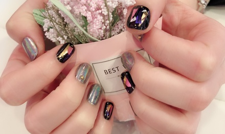 One Gel Mani or Pedi with Hot-Stone Massage Nail Art Set at Nels Beauty Salon (Up to 56% Off)