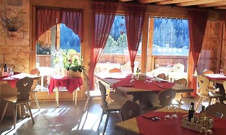 Menu cadorino gourmet o alla carta con vino abbinato per 2 persone al ristorante Taulà dei Bos (sconto fino a 65%)