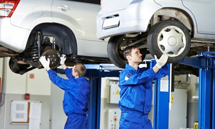 Brake Pad Replacement for Two Wheels or Complete Air-Conditioning Service at United Auto Service (Up to 51% Off)