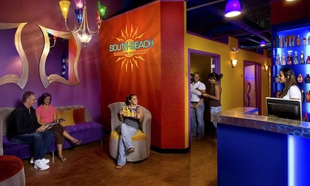 One Month of Unlimited Level 1 or 2 UV Tanning or Two VersaSpa Spray Tans at South Beach Tanning Company (Up to 52% Off)