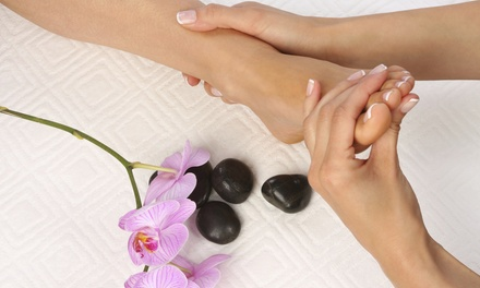 One or Three 50-Minute Therapeutic or Hot-Stone Foot Massages at One Salon (Up to 56% Off)