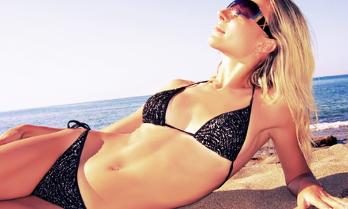 Boca Tanning Club - Pompano Beach: Two Norvell Airbrush Tans, Three VersaSpray Spray Tans, or One Month of UV Tanning at Boca Tanning Club (Up to 80% Off)