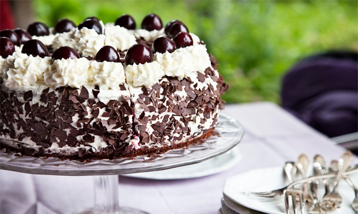 Q's Cakes - Indian Moon: One-Dozen Large Chocolate-Covered Oreos or $20 Worth of Baked Goods and Treats at Q's Cakes (Up to 45% Off)
