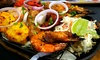 Island Flavas - Greenwich: Two-Course Caribbean Meal for Two or Four at Island Flavas (Up to 69% Off)