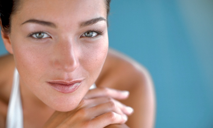Reveal Beyond - Sunny Side: Two or Four Radio-Frequency Skin-Tightening Treatments at Reveal Beyond (Up to 52% Off)