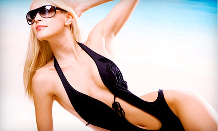 Executive Smiles - Garland: One, Two, or Three Spray Tans at Executive Smiles in Garland (Up to 61% Off)