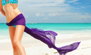 Nancy's Esthetics: One or Three Infrared Body Wraps or One Brazilian Wax at Nancy's Esthetics (Up to 53% Off)