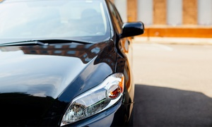The Wheel Deal: Rain-Repellent Windshield Treatment or Headlight Restoration at The Wheel Deal (Up to 73% Off)