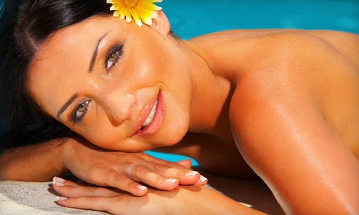 Unlimited Tan - Multiple Locations: Spray- or UV-Tanning Packages at Unlimited Tan (Up to 86% Off). Two Options Available.