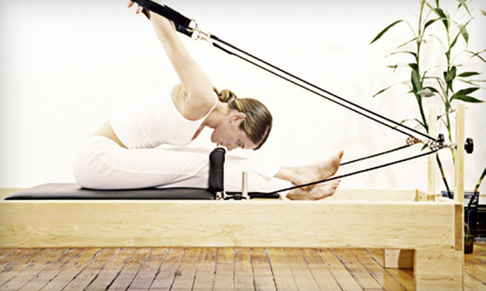 Pure Pilates - Multiple Locations: 5 or 10 Reformer Pilates Classes or One Month of Unlimited Classes at Pure Pilates (Up to 73% Off)