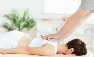 100% Chiropractic: Chiropractic Exam, Adjustment, and One or Two 60-Minute Massages at 100% Chiropractic (Up to 76% Off)