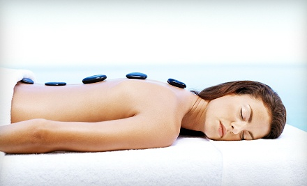 $99 for a Spa Package with a Hot-Stone Massage, Facial, and Body Wrap at The Spa At The Village ($475 Value)