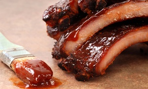 Buffalo Bill's Barbecue: Barbecue for Two or More, or Take-Out at Buffalo Bill's Barbecue (35% Off)