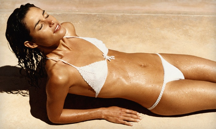 Darque Tan - Multiple Locations: Two Spray Tans, Five UV Tans, or One Month of UV Tanning at Darque Tan (Up to 71% Off)