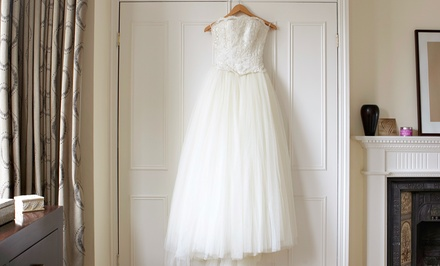 Wedding-Gown Cleaning or Dry Cleaning Services at First Class Dry Cleaners (Up to 52% Off)