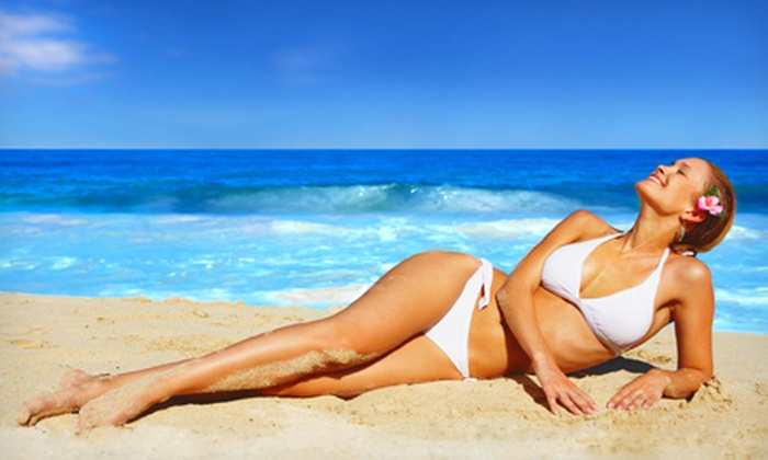 Tanning Haven - Multiple Locations: Month of Unlimited Tanning or Custom Airbrush Tan, or Three Custom Airbrush Tans at Tanning Haven (Up to 72% Off)