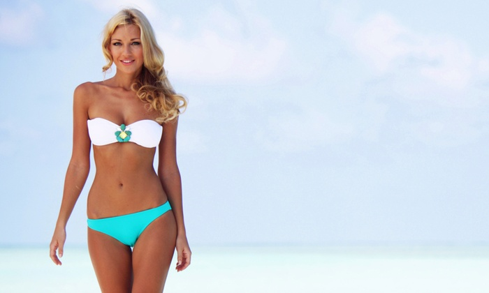 JIll's Beach - Multiple Locations: Two Mystic Spray Tans or Five Tanning Bed Sessions at Jill's Beach (Up to 77% Off)
