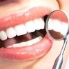 77% Off Dental Exam with Take-Home Whitening Kit