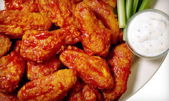 Wing Zone - Green Bay: $10 for 25 Boneless or Original Chicken Wings at Wing Zone (Up to $19.74 Value)