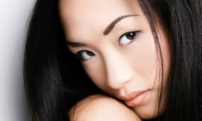 Bare Essentials - Downtown Vancouver: One or Two Microdermabrasion Treatments with A' la Carte Services at Bare Essentials Skin Bar (Up to 68% Off)