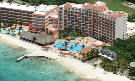 groupon daily deal - All-Inclusive El Cozumeleno Resort Vacation with Airfare. Price/Person Based on Double Occupancy. Includes Taxes & Fees.