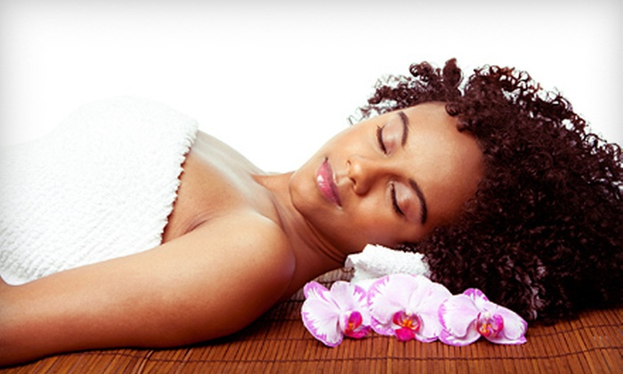 European Skin & Hair Clinic - Southeastern Columbia: Body Wrap and Massage or Spa Day Packages at European Skin & Hair Clinic (Up to 56% Off) Three Options Available.