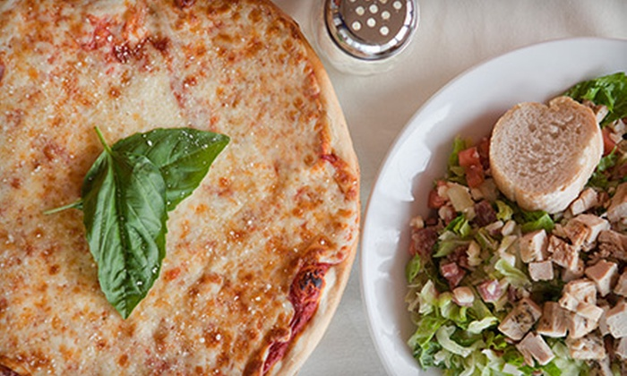 The Pizza Co. - Chapel Ridge: Two or Four Specialty or One-Topping Pizzas at The Pizza Co. (Up to Half Off)